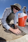 Lindsey Daub, Far Western Anthropological Research Group staff archaeologist, works at an archaeological dig site on the Utah Test and Training Range, July 13, 2016. Daub and her colleagues have found tools, charcoal, water fowl bone fragments, and tooling flakes, which provide evidence of wetlands and human presence in the area more than 12,000 years ago. (U.S. Air Force photo by Todd Cromar)