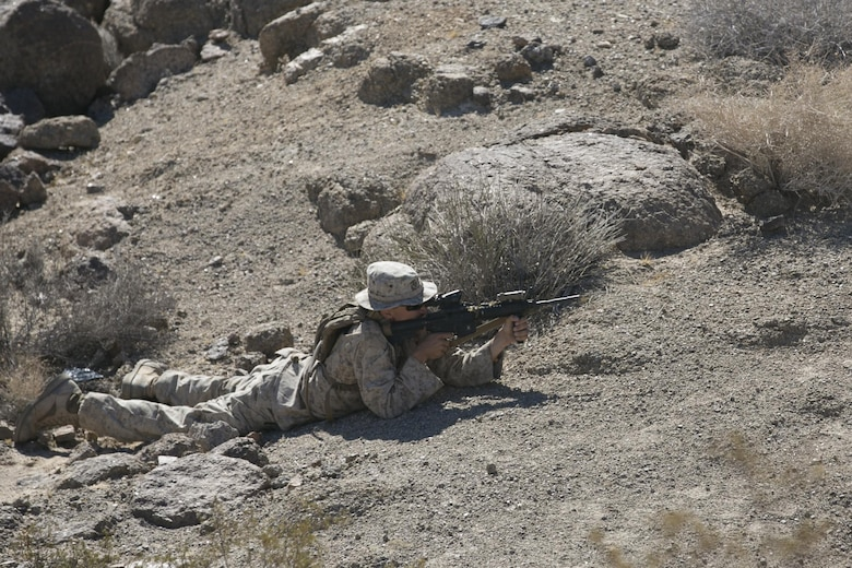 Cpl. Trent Maxell, teamleader, 3rd Battalion, 4th Marines, 7th Marine Regiment, sights in during an immediate action practical application exercise held as part of the Tactical Small Unit Leaders' Course aboard Marine Corps Air Ground Combat Center, Twentynine Palms, Calif., July 14, 2016. (Official Marine Corps photo by Cpl. Thomas Mudd/Released)