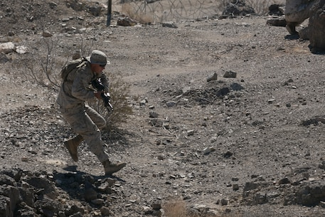 Cpl. Andrew Greenfield, squad leader, 3rd Battalion, 4th Marines, 7th Marine Regiment, runs to cover during immediate action practical application exercise held as part of the Tactical Small Unit Leaders' Course aboard Marine Corps Air Ground Combat Center, Twentynine Palms, Calif., July 14, 2016. (Official Marine Corps photo by Cpl. Thomas Mudd/Released)
