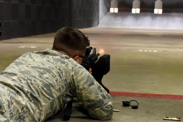 Airman 1st Class Andrew Fonke, 4th Logistics Readiness Squadron fleet management and analysis specialist, fires practice rounds during a Combat Arms Training and Maintenance class July 22, 2016, at Seymour Johnson Air Force Base, North Carolina. CATM classes are two-days long and consist of battle drills, basic fundamentals, and analyzing different weapons. (U.S. Air Force photo by Airman Miranda A. Loera)