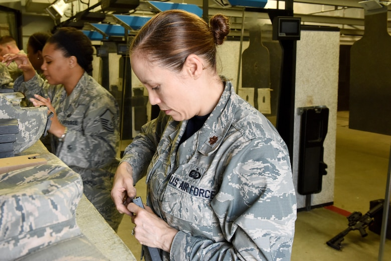 Maj. Coulette Swiggett, 4th Force Support Squadron operations officer, loads a magazine with ammunition during a Combat Arms Training and Maintenance class July 22, 2016, at Seymour Johnson Air Force Base, North Carolina. Airmen must qualify in different portions of shooting before they can be certified and released for deployment. (U.S. Air Force photo by Airman Miranda A. Loera)