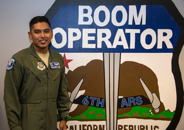 Senior Airman Andres Castillo, 6th Air Refueling Squadron boom operator, poses for a photo within his squadron at Travis Air Force Base, Calif., July 20, 2016. (U.S. Air Force photo by Staff Sgt. Charles Rivezzo)