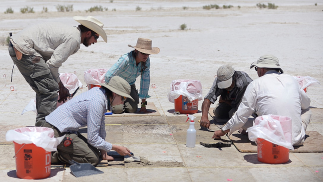 Archaeologists excavate a site on the Utah Test and Training Range, July 13, 2016. The team found tools, charcoal, water fowl bone fragments, and tooling flakes, which provide evidence of wetlands and human presence in the area more than 12,000 years ago. (U.S. Air Force photo by Todd Cromar)