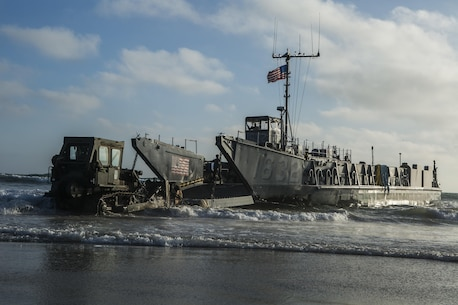 MARINE CORPS BASE CAMP PENDLETON, Calif. -  Sailors from the Makin Island Amphibious Ready Group unload a landing craft, utility at Camp Pendleton July 19, 2016. The LCU launched from the USS Comstock (LSD 45) and carried a Beach Master Unit's equipment and a combined anti-armor team from the 11th Marine Expeditionary Unit to shore. Amphibious Squadron 5 and the 11th MEU are working together to prepare for their upcoming deployment later this year. (U.S. Marine Corps photo by Sgt. Anna Albrecht/ Released)