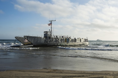 MARINE CORPS BASE CAMP PENDLETON, Calif. -  Sailors from the Makin Island Amphibious Ready Group approach the shore in a landing craft, utility at Camp Pendleton July 19, 2016. The LCU launched from the USS Comstock (LSD 45) and carried a Beach Master Unit's equipment and a combined anti-armor team from the 11th Marine Expeditionary Unit to shore. This gave the LCUs practice landing in the surf and transporting equipment from ship to shore. (U.S. Marine Corps photo by Sgt. Anna Albrecht/Released)