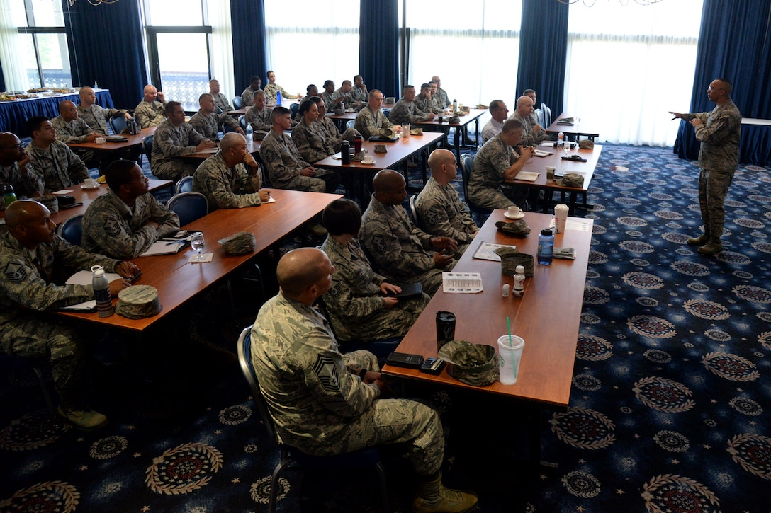 Air Force District of Washington First Sergeant Chief Master Sgt. Manny Pineiro speaks to attendees during the first ever AFDW First Sergeant Conference at Joint Base Anacostia-Bolling July 18, 2016. The event provided an opportunity for enlisted leadership and first sergeants from across the National Capital Region to discuss the needs of Airman. (U.S. Air Force photo/Tech. Sgt. Matt Davis)