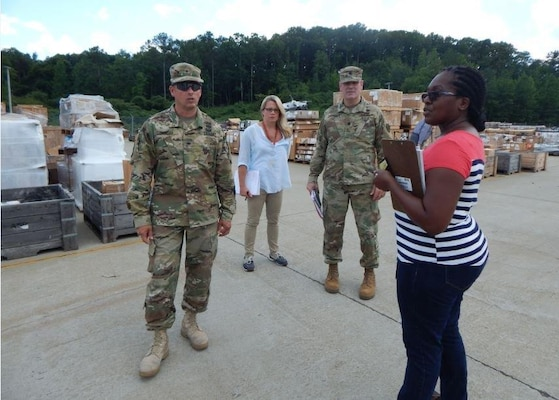 Army Lt. Col. Michael Lindley, DLA Distribution Anniston, Ala., commander, talks with Army Brig. Gen. John Laskodi, DLA Distribution commander, about the incoming volume of material at the distribution center and the organization's support to DLA Disposition Services.  Also pictured are Jennifer Watson, DLA Distribution Anniston operations officer, and Latoya Twymon, DLA Distribution Anniston D2 Demilitarization Disposition supervisor.
