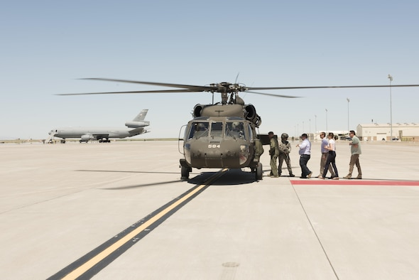 Congressional advisors board a UH-60 Black Hawk at Mountain Home Air Force Base, Idaho, July 19, 2016. They flew to Saylor Creek range where advisors learned about ways the 266th Range Squadron simulates threats to create a more realistic training environment for aircrews. (U.S. Air Force photo by Airman Alaysia Berry/Released)