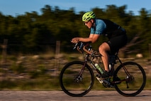 Staff Sgt. Kyle Emmel, a 17th Training Group student, cycles down a gravel road in San Angelo, Texas, July 18, 2016. Emmel is training for a race that stretches from Oregon to Virginia. The coast-to-coast race will be held in 2017. (U.S. Air Force photo/Senior Airman Devin Boyer)