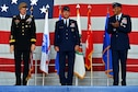 U.S. Army Gen. Joseph L. Votel, U.S. Central Command commander, stands with U.S. Air Force Lt. Gen. Jeffrey L. Harrigian., U.S. Air Forces Central Command commander, and  U.S. Air Force Lt. Gen. Charles Q. Brown Jr., U.S. Air Forces Central Command outgoing commander, during a change of command ceremony at Shaw Air Force Base, S.C., July 22, 2016. Outgoing and incoming commanders exchange a unit's guidon to symbolize relinquishment and assumption of command. (U.S. Air Force photo by Airman 1st Class Christopher Maldonado/Released)