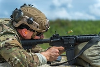 Air Force Staff Sgt. Joshua Kinney fires his M-4 rifle during the Fourth Annual Spc. Hilda I. Clayton Best Combat Camera Competition at Fort A.P. Hill, Va., July 12, 2016. Kinney is a combat cyber transport journeyman assigned to the 1st Combat Camera Squadron. Air Force photo by Staff Sgt. Kenneth W. Norman