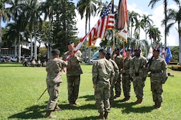 Col. Peter B. Andrysiak (r) receives the Army Colors from Lt. Gen. Todd T. Semonite during a Change-of-Command ceremony July 12, on Palm Circle, Fort Shafter. Andrysiak became the 32nd commander of the Pacific Ocean Division, U.S. Army Corps of Engineers.