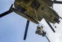 A Marine student fast-ropes out of a CH-53E Super Stallion helicopter during operations at Camp Lejeune, N.C., July 13, 2016. The course is a new, shortened version of the helicopter rope-suspension training course and focuses on qualifying Marines as subject matter experts within their subordinate command. Marine Corps photo by Lance Cpl. Preston McDonald