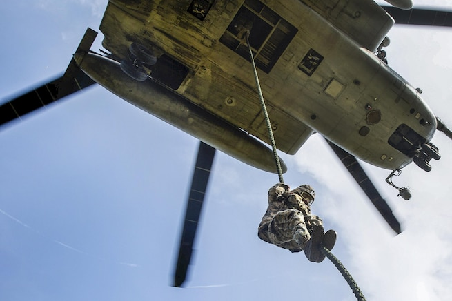 A Marine student fast-ropes out of a CH-53E Super Stallion helicopter during operations at Camp Lejeune, N.C., July 13, 2016. The course is a new, shortened version of the helicopter rope-suspension training course. Marine Corps photo by Lance Cpl. Preston McDonald