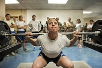 Air Force Master Sgt. Lindsey Glover participates in the squat event portion of a powerlifting competition at Bagram Airfield, Afghanistan, July 15, 2016. Glover is assigned to the 455th Expeditionary Aircraft Maintenance Squadron. Air Force photo by Capt. Korey Fratini