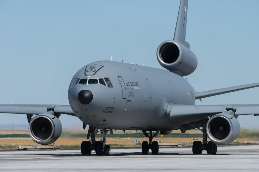 "A KC-10 Extender from Travis Air Force Base, California rolls down the taxiway at Mountain Home Air Force Base, Idaho, July 20, 2016. ""Heavies"" such as the KC-10 fulfill multiple different roles in downrange scenarios such as air refueling, personnel and cargo transport and even reconnaissance. (U.S. Air Force photo by Senior Airman Connor J. Marth/RELEASED)"