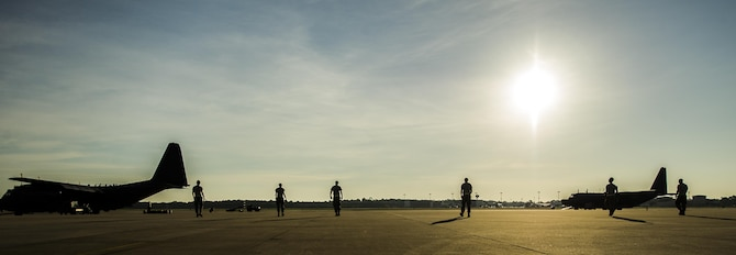 Air Commandos from the 15th Aircraft Maintenance Unit perform a foreign object damage walk at Hurlburt Field, Fla., July 20, 2016. During a F.O.D. walk, Airmen spread out and pick up any loose objects they see that could damage the aircraft. (U.S. Air Force photo by Airman 1st Class Isaac O. Guest)