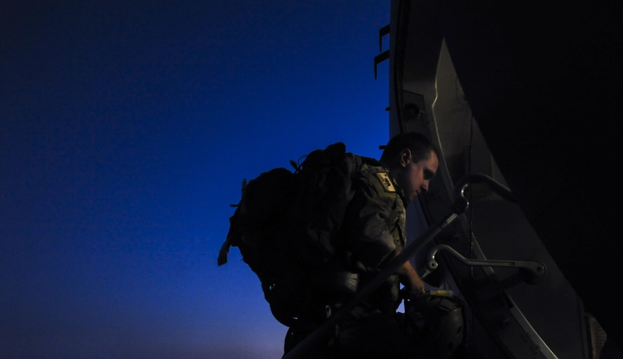 A Survival Evasion Resistance Escape Specialist, assigned to the 414th Combat Training Squadron, enters a C-17 before a training mission during Red Flag 16-3 at Nellis Air Force Base, Nev., July 20, 2016. Red Flag involves a variety of attack, fighter, bomber, reconnaissance, electronic warfare, airlift support, and search and rescue aircraft. (U.S. Air Force photo by Airman 1st Class Kevin Tanenbaum/Released)