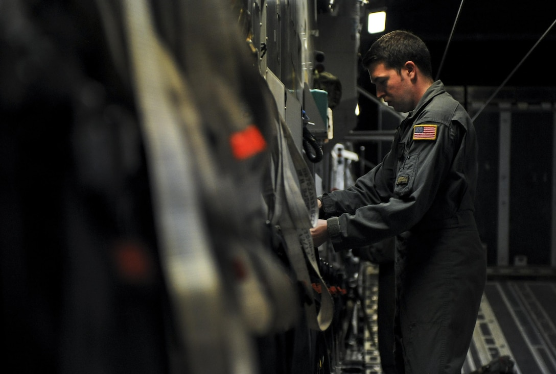 Senior Airman Nick Church, 437th Airlift Wing, Joint Base Charleston, S.C., loadmaster, places seats upright before take-off inside a C-17 during Red Flag 16-3 at Nellis Air Force Base, Nev., July 20, 2016. Red Flag is a realistic combat training exercise involving the air, space and cyber forces of the U.S. and its allies. (U.S. Air Force photo by Airman 1st Class Kevin Tanenbaum/Released)