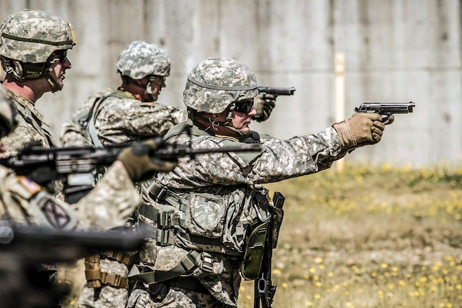 Soldiers conduct a reflexive-fire exercise at Joint Base Lewis-McChord, Wash., July 15, 2016. The soldiers trained with M4 carbine and M9 pistols to enhance tactical proficiency. Army photo by Capt. Brian Harris