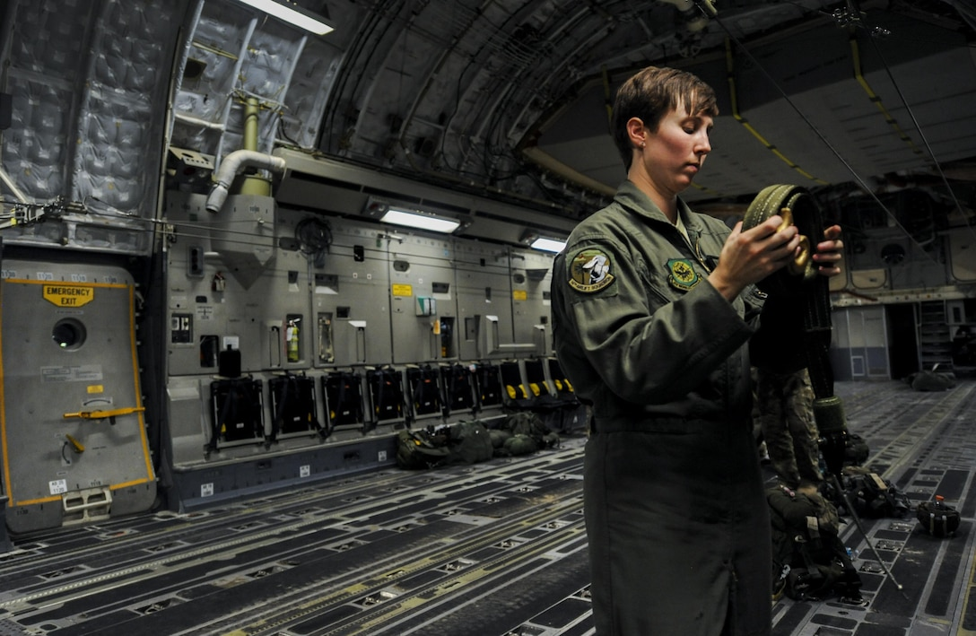 Senior Airman Ashley Igalo, 437th Airlift Wing, Joint Base Charleston, S.C., loadmaster, prepares the interior of a C-17 for Survival Evasion Resistance Escape specialist's static line jumps during Red Flag 16-3 at Nellis Air Force Base, Nev., July 20, 2016. All four branches of the U.S. Military participate in the Red Flag training conducted on the vast bombing and gunnery ranges of the Nevada Test and Training Range. (U.S. Air Force photo by Airman 1st Class Kevin Tanenbaum/Released)