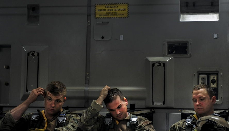 Survival Evasion Resistance Escape specialists, assigned to the 414th Combat Training Squadron Nellis Air Force Base, Nev., wait for take-off on a C-17 during Red Flag 16-3 July 20, 2016. The air-to-air combat training exercise is conducted over the 2.9 million acre Nevada Test and Training Range. (U.S. Air Force photo by Airman 1st Class Kevin Tanenbaum/Released)