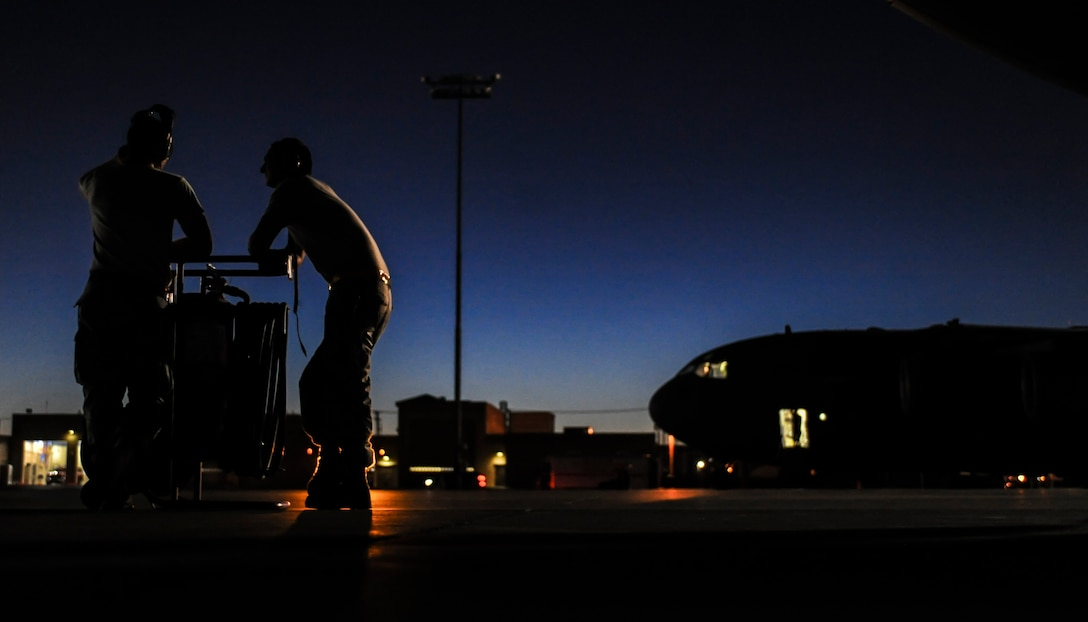Staff Sgt. Austin Overbaugh, 437th Aircraft Maintenance Squadron, Joint Base Charleston, S.C., aerospace propulsion maintainer, and Staff Sgt. Adrian Rincones, 437th AMXS crew chief prepare a C-17 for take-off during Red Flag 16-3 at Nellis Air Force Base, Nev., July 20, 2016. Red Flag enhances aircrew's combat readiness and survivability by challenging them with realistic combat scenarios. (U.S. Air Force photo by Airman 1st Class Kevin Tanenbaum/Released)