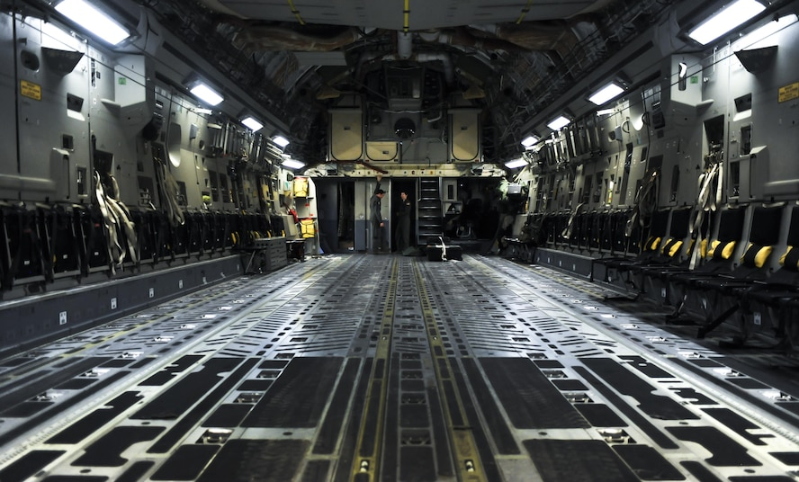 Senior Airmen Nick Church and Ashley Igalo, 437th Airlift Wing, Joint Base Charleston, S.C., loadmasters, prepare the interior of a C-17 before take-off during Red Flag 16-3 at Nellis Air Force Base, Nev., July 20, 2016. Red Flag provides a series of intense air-to-air scenarios for aircrew and ground personnel which will increase their combat readiness and effectiveness for future real world missions. (U.S. Air Force photo by Airman 1st Class Kevin Tanenbaum/Released)