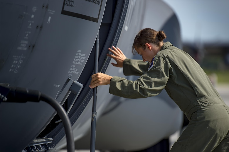 U.S. Air Force Capt. Christy Wise, 71st Rescue Squadron pilot, climbs into an HC-130J Combat King II for her first flight since becoming an above-the-knee amputee, July 22, 2016, at Moody Air Force Base, Ga. Wise underwent nearly 15 months of rehabilitation before she was cleared to fly. (U.S. Air Force Photo by Senior Airman Ryan Callaghan)