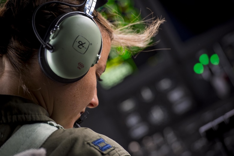 U.S. Air Force Capt. Christy Wise, 71st Rescue Squadron HC-130 J Combat King II pilot, looks over flight plans prior to her first flight since becoming an above-the-knee amputee, July 22, 2016, at Moody Air Force Base, Ga. Wise says her goal from day one after the accident was to return to the cockpit. (U.S. Air Force Photo by Senior Airman Ryan Callaghan)