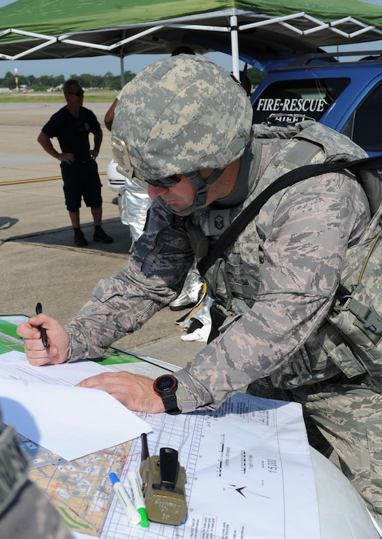Master Sgt. Joseph Freiesleben, 81st Security Forces Squadron logistics and resources superintendent, coordinates patrol responses and tactical forces positioning in order to secure the incident scene during an anti-hijacking exercise on the flightline July 21, 2016, on Keesler Air Force Base, Miss. The exercise was used to test and maintain the ability of Keesler units to react and respond to developing situations. (U.S. Air Force photo by Kemberly Groue/Released)