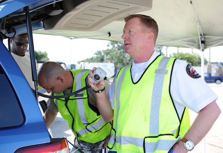 Gary Pierson, 81st Infrastructure Division deputy fire chief, relays information to squadron personnel during an anti-hijacking exercise on the flightline July 21, 2016, on Keesler Air Force Base, Miss. The exercise was used to test and maintain the ability of Keesler units to react and respond to developing situations. (U.S. Air Force photo by Kemberly Groue/Released)