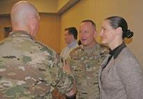 Col. John Lawrence, incoming commander of the Fort Riley garrison, greets Command Sgt. Major Billy Counts, senior noncommissioned officer of the 97th Military Police Battalion, in the receiving line during the garrison change of command ceremony July 13 at Riley's Conference Center. At right is administrative specialist Tara Pierce.