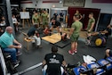 Airman 1st Class Raymond Carney, 336th Training Squadron student, performs a deadlift during the annual Muscle Mania event at the Triangle Fitness Center July 16, 2016, on Keesler Air Force Base, Miss. The powerlifting event was open to men and women and featured squat, deadlift and bench press categories. (U.S. Air Force photo by Marie Floyd/Released)