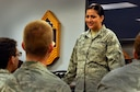 Tech. Sgt. Cassandra Cruz, 81st Force Support Squadron Airman Leadership School instructor instructs a group of students at the ALS building, July 21, 2016, on Keesler Air Force Base, Miss. Cruz was selected as one of this year's 12 Outstanding Airmen of the Year. Volunteers assisted in providing staged photos of Cruz on the job for display in the Pentagon. (U.S. Air Force photo by Tech. Sgt. Kimberly Rae Moore/Released)