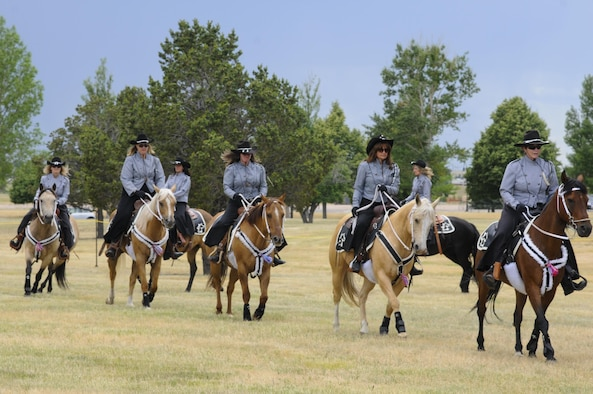 Members of the Trotters turn a corner in a column as they demonstrate their horse-riding skills July 22, 2016, during Fort D.A. Russell Days, the annual F.E. Warren Air Force Base, Wyo., open house. The Trotters perform at the open house each year. (U.S. Air Force photo by Senior Airman Jason Wiese)