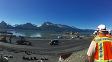 The USACE Alaska District is constructing the foundation for a new breakwater from land during low tide at Valdez Harbor in Alaska. Once the base layer is in place, building from the water side will commence. Meanwhile, a dredge continues to excavate the harbor and navigation channels.