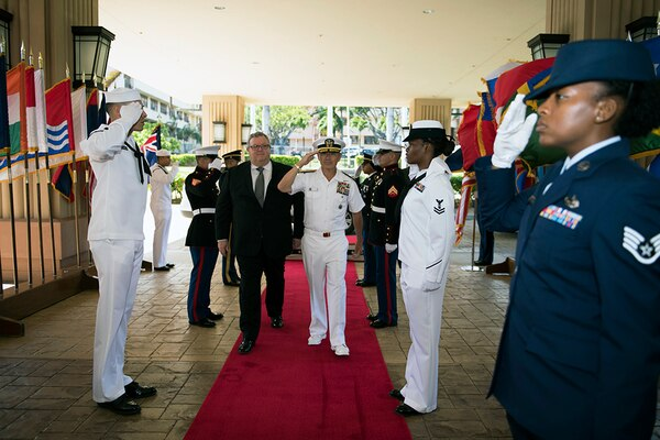 (July 22, 2016) - CAMP H.M. SMITH, Hawaii (July 22, 2016) - Commander of U.S. Pacific Command (USPACOM), Adm. Harry B. Harris Jr., right, and New Zealand Minister of Defense, Gerry Brownlee, render honors during a welcome ceremony. Harris met with Brownlee at the USPACOM headquarters to discuss the security environment in the Indo-Asia-Pacific and planned ongoing activities in the USPACOM area of responsibility, including the United States Government's plan to conduct its first U.S. Navy ship visit to New Zealand in over three decades as part of the International Fleet Review associated with the Royal New Zealand Navy's 75th anniversary celebration in November 2016. (DoD photo by Chief Mass Communication Specialist Patrick Dille)