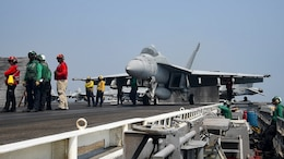 An F/A-18E Super Hornet assigned to the Sidewinders of Strike Fighter Squadron (VFA) 86 prepares to launch from the aircraft carrier USS Dwight D. Eisenhower (CVN 69) in support of air strikes from the Arabian Gulf. Dwight D. Eisenhower and its carrier strike group are deployed in support of Operation Inherent Resolve, maritime security operations and theater security cooperation efforts in the U.S. 5th Fleet area of operations.