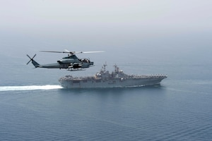 An AH-1Z Viper helicopter, assigned to the 13th Marine Expeditionary Unit (MEU), patrols waters near the amphibious assault ship USS Boxer (LHD 4). Boxer is the flagship for the Boxer Amphibious Ready Group and, with the embarked 13th MEU, is deployed in support of Operation Inherent Resolve, maritime security operations and theater cooperation efforts in the U.S. 5th Fleet area of operations.