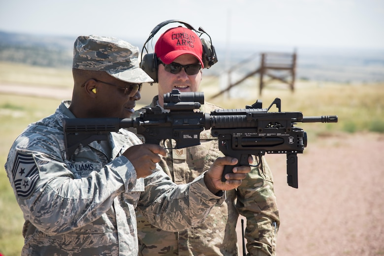 Chief Master Sgt. Calvin Williams, AFGSC command chief, fires a grenade launcher at the 620th Ground Combat Training Squadron at Camp Guernsey, Wyo., July 21, 2016. During the visit, Williams tested and reviewed weapons used by security forces personnel. (U.S. Air Force photo by Senior Airman Malcolm Mayfield)