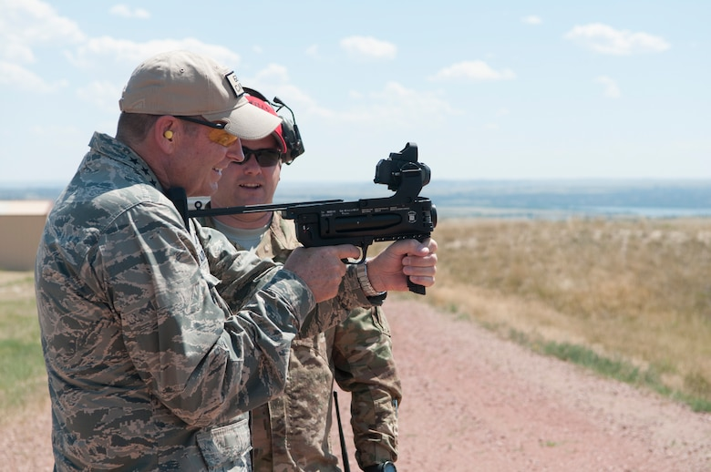 Gen. Robin Rand, AFGSC commander, fires a grenade launcher, during his visit with the 620th Ground Combat Training Squadron at Camp Guernsey, Wyo., July 21, 2016. Security Forces Airmen in AFGSC train at Camp Guernsey to maintain and enhance their proficiency in securing nuclear assets. (U.S. Air Force photo by Senior Airman Malcolm Mayfield)