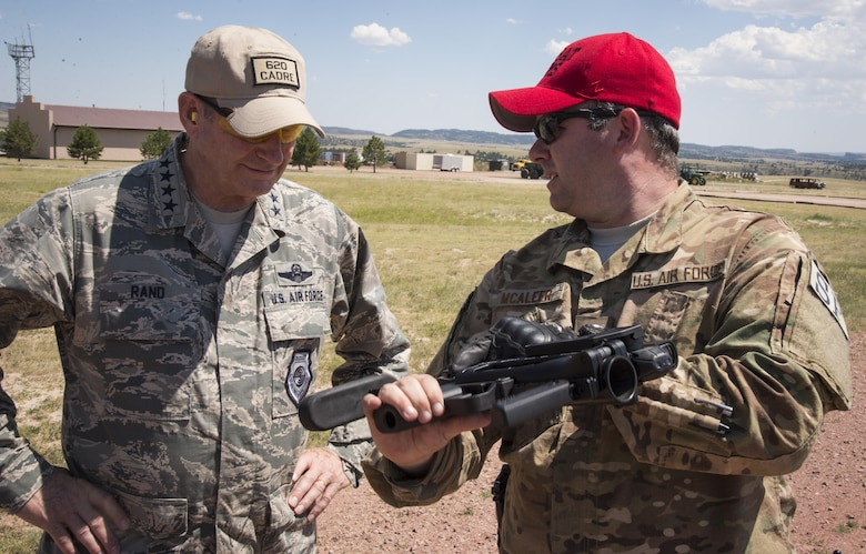 Tech. Sgt. Christopher Mcaleer, 620th Ground Combat Training Squadron cadre member, explains the firing capability of a weapon to Gen. Robin Rand, AFGSC commander, at Camp Guernsey, Wyo., July 21, 2016. Rand visited with several security forces Airmen to learn about the mission of the 620th GCTS. (U.S. Air Force photo by Senior Airman  Malcolm Mayfield)