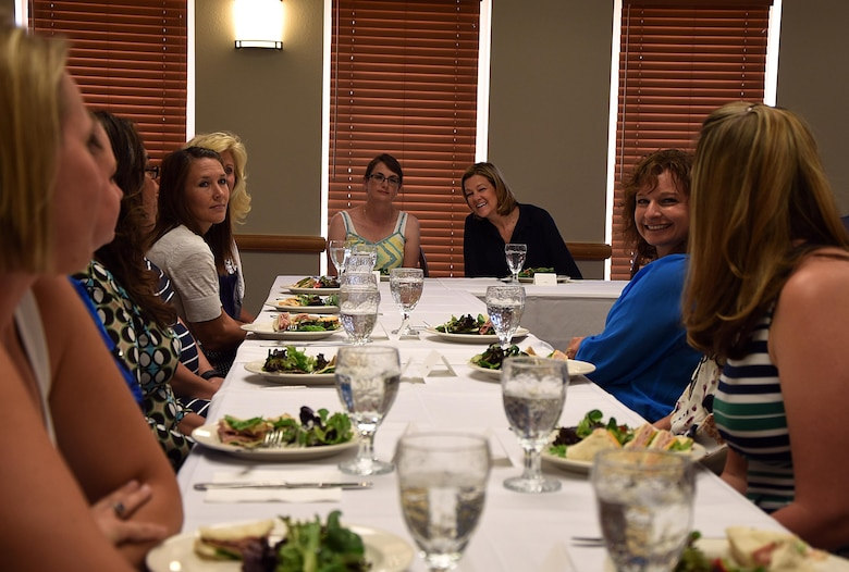 Aundrea Kravitsky, wife of 90th Missile Wing Commander Col. Stephen Kravitsky, and Kim Rand, wife of AFGSC Commander Gen. Robin Rand, listen as a 90 MW key spouse talks about the program, July 22, 2016, during a luncheon on F.E. Warren Air Force Base, Wyo. Mrs. Rand listened to several spouses and shared her advice on how to better the program. (U.S. Air Force photo by Senior Airman Brandon Valle)