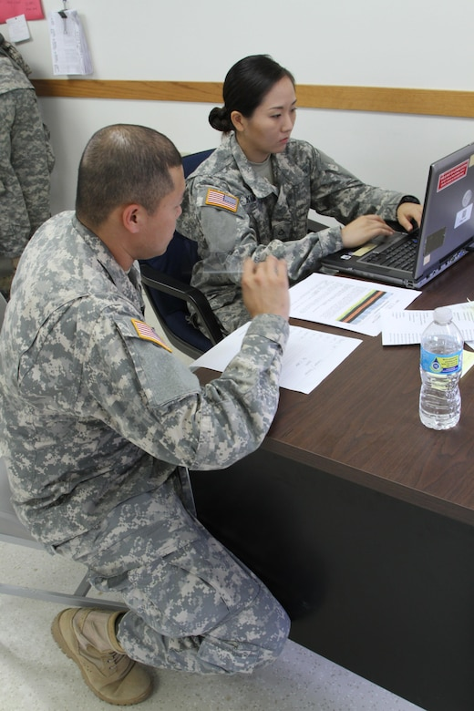 FT. MCCOY, Wisc. – Sgt. Wirad Sajjawerawan, left, and Pfc. Minsun Kim, members of the 931st Expeditionary Theatre Opening Element based out of Sherman Oaks, Calif., review the cargo movement scenario given to them as part of the Trans Warrior exercise, held here July 9 through 23. Trans Warrior provides U.S. Army Reserve transportation Soldiers an opportunity to train realistically on port operations. (U. S. Army Reserve photo by Sgt. Charlotte Fitzgerald, 345th Public Affairs Detachment)