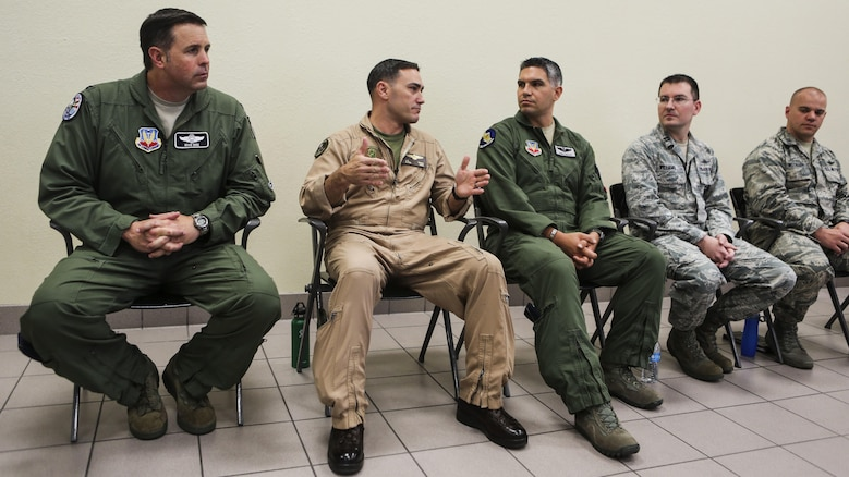 Lt. Col. J.T. Bardo, second from left, commanding officer of Marine Fighter Attack Squadron 121, answers questions about the F-35B Lightning II participating in exercise Red Flag 16-3 at Nellis Air Force Base, Nevada, July 20. This is the first time that the fifth generation fighter has participated in the multiservice air-to-air combat training exercise.
