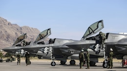 Pilots with Marine Fighter Attack Squadron 121 exit F-35B Lightning II's after conducting training during exercise Red Flag 16-3 at Nellis Air Force Base, Nevada, July 20, 2016. This is the first time that the fifth generation fighter has participated in the multiservice air-to-air combat training exercise.