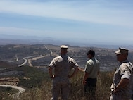 Brig. Gen. Kevin Killea, Commanding General, Marine Corps Installations - West / Marine Corps Base Camp Pendleton, and SgtMaj. Julio Meza, MCI-West / Marine Corps Base Camp Pendleton SgtMaj., tour Camp Pendleton with members of the U. S. Forestry Service during a brush fire, July 24, 2016. The fire, which began July 21, burned 1,454 acres aboard Camp Pendleton. Photo courtesy Col. Patrick Gramuglia.