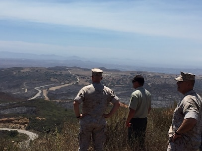 Brig. Gen. Kevin Killea, Commanding General, Marine Corps Installations - West / Marine Corps Base Camp Pendleton, and SgtMaj. Julio Meza, MCI-West / Marine Corps Base Camp Pendleton SgtMaj., tour Camp Pendleton with members of the U. S. Forest Service during a brush fire, July 24, 2016. The fire, which began July 21, burned over 1,300 acres aboard Camp Pendleton. Photo courtesy Col. Patrick Gramuglia.