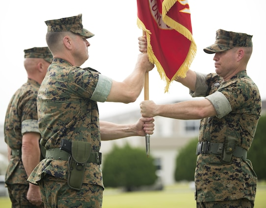 U.S. Marine Corps Col. Robert V. Boucher, outgoing commanding officer of Marine Corps Air Station Iwakuni, Japan, receives the U.S. Marine Corps colors from U.S. Marine Corps Sgt. Maj. Christopher J. Garza, Sergeant major of MCAS Iwakuni, during a change of command ceremony at MCAS Iwakuni, July 22, 2016. Residents, locals and guests gathered aboard Marine Corps Air Station Iwakuni to witness U.S. Marines and sailors welcome Col. Richard Fuerst as their new commanding officer. (U.S. Marine Corps photo by Lance Cpl. Donato Maffin)